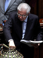 Il leader di Scelta Civica e Presidente del Consiglio Mario Monti vota durante la terza seduta comune di senatori e deputati per l'elezione del nuovo Capo dello Stato alla Camera dei Deputati, Roma, 19 aprile 2013..Italian Premier and Civic Choice party's leader Mario Monti votes during the third common plenary session of senators and deputies to elect the new Head of State, at the Lower Chamber in Rome, 19 April 2013..UPDATE IMAGES PRESS/Isabella Bonotto