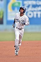 Asheville Tourists shortstop Carlos Herrera (4) rounds the bases after hitting a home run during a game against the Columbia Fireflies at McCormick Field on June 17, 2016 in Asheville, North Carolina. The Tourists defeated the Fireflies 6-2. (Tony Farlow/Four Seam Images)