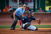 Elizabethton Twins catcher Andrew Cosgrove (5) awaits the pitch in front of home plate umpire Kyle Stutz during a game against the Bristol Pirates on July 28, 2018 at Joe O'Brien Field in Elizabethton, Tennessee.  Elizabethton defeated Bristol 5-0.  (Mike Janes/Four Seam Images)