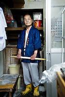 MAY 15, 2014 - KOJIMA, KURASHIKI, JAPAN: A chef wearing Happi coat made of Denim fabric, while cooks in the counter at  Udon nudle restaurant .  (Photograph / Ko Sasaki)