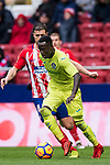 Amath Ndiaye Diedhiou (R) of Getafe CF battles for the ball with Gabriel Fernandez Arenas, Gabi, of Atletico de Madrid during the La Liga 2017-18 match between Atletico de Madrid and Getafe CF at Wanda Metropolitano on January 06 2018 in Madrid, Spain. Photo by Diego Gonzalez / Power Sport Images
