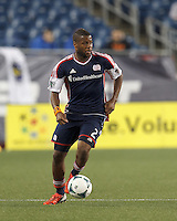 New England Revolution defender Andrew Farrell (2) brings the ball forward.  In a Major League Soccer (MLS) match, Real Salt Lake (white)defeated the New England Revolution (blue), 2-1, at Gillette Stadium on May 8, 2013.