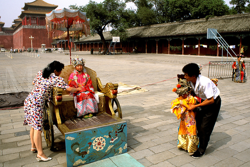 Young children dress up like the king in Beijing China