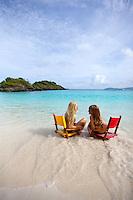 Girls in beach chairs at Trunk Bay.Virgin Islands National Park.  St. John, U.S. Virgin Islands