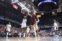GREENSBORO, NC - MARCH 07: Georgia Pineau #5 of Boston College shoots over Grace Hunter #23 of North Carolina State University during a game between Boston College and NC State at Greensboro Coliseum on March 07, 2020 in Greensboro, North Carolina.