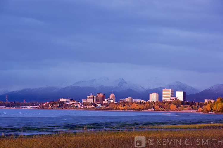 The Anchorage Skyline at sunset, taken from the Tony Knowles Coastal Trail, fall, Anchorage, Southcentral Alaska, USA.