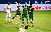 CARSON, CA - OCTOBER 07: Jorge Villafana #4 and Diego Valeri #8 of the Portland Timbers celebrate a Portland goal during a game between Portland Timbers and Los Angeles Galaxy at Dignity Heath Sports Park on October 07, 2020 in Carson, California.