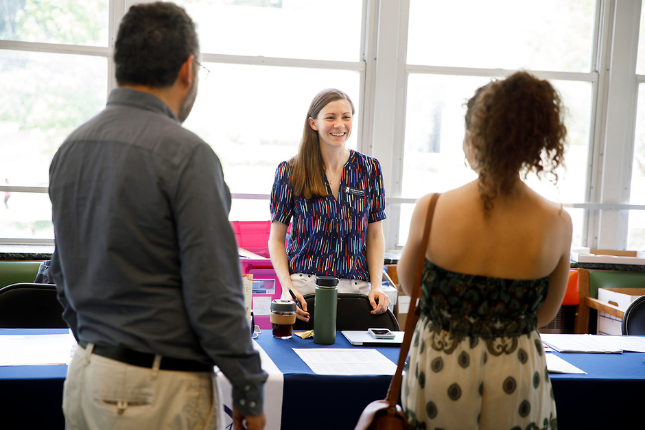 USA International Harp Competition Executive Director Erin Brooker-Miller helps Myriam Blardone of Canada at contestant registration during the 11th USA International Harp Competition at Indiana University in Bloomington, Indiana on Tuesday, July 2, 2019. (Photo by James Brosher)