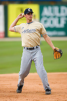 Jeff Hehr (32) of the Lake County Captains makes a throw during fielding practice at Fieldcrest Cannon Stadium in Kannapolis, NC, Saturday, April 26, 2008.
