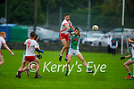 High fielding action as Na Gaeil's Jack Barry and Eanna O'Chonchuir of An Ghaeltacht tussle in mid air in the Intermediate Club Football Championship