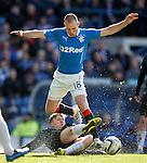Paul Watson halts the progress of Kenny Miller