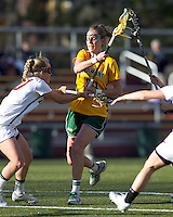 University of Vermont midfielder Adison Rounds (23) on the attack as Boston College midfielder Kate McCarthy (20) defends. Boston College defeated University of Vermont, 15-9, at Newton Campus Field, April 4, 2012.