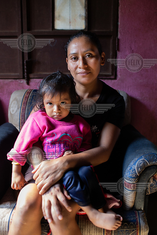 Ada Camposeco, 34, who was born in Chiapas, Mexico, while the community was there as war refugees, holds her daughter Keren Esmeralda Esperanza, 19 months old, who was born while the community was living in a temporary shelter after the Fuego Volcano eruption in June 2018 in the 15 de Octubre La Trinidad. Ada, a mother of three and married to Estuardo Lorenzo, states: ''For me, the word 'no' does not exist. This is what I tell my kids, to keep going regardless what comes your way!''