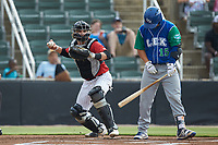 Kannapolis Intimidators catcher Michael Hickman (16) checks the runner at first base during the game against the Lexington Legends at Kannapolis Intimidators Stadium on August 4, 2019 in Kannapolis, North Carolina. The Legends defeated the Intimidators 5-1. (Brian Westerholt/Four Seam Images)