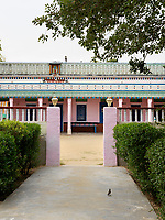 Inscribed above the entrance to the house is the family's tribal name and presiding over everything from the centre of the parapet is a sculpture of Lord Krishna