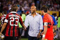 New York Yankees closing pitcher Mariano Rivera shakes hands with Massimo Ambrosini (23) of A. C. Milan after the coin toss. Real Madrid defeated A. C. Milan 5-1 during a 2012 Herbalife World Football Challenge match at Yankee Stadium in New York, NY, on August 8, 2012.