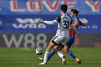 Andros Townsend of Crystal Palace battles with Antonee Robinson of Fulham during the Premier League behind closed doors match between Crystal Palace and Fulham at Selhurst Park, London, England on 28 February 2021. Photo by Vince Mignott / PRiME Media Images.