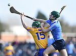 Cathal Mc Inerney of Clare in action against James Madden of Dublin during their National Hurling League game at Cusack Park. Photograph by John Kelly.