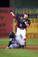 Batavia Muckdogs second baseman Mike Garzillo (11) throws to first as Gavin Collins (44) slides in during a game against the Mahoning Valley Scrappers on August 18, 2016 at Dwyer Stadium in Batavia, New York.  Batavia defeated Mahoning Valley 2-1 in twelve innings. (Mike Janes/Four Seam Images)