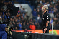 Referee Martin Atkinson studies the pitch side monitor to determine whether James Ward-Prowse should receive a red card during Chelsea vs Southampton, Premier League Football at Stamford Bridge on 2nd October 2021