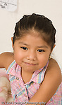 portrait of 3 year old girl closeup vertical Mexican American