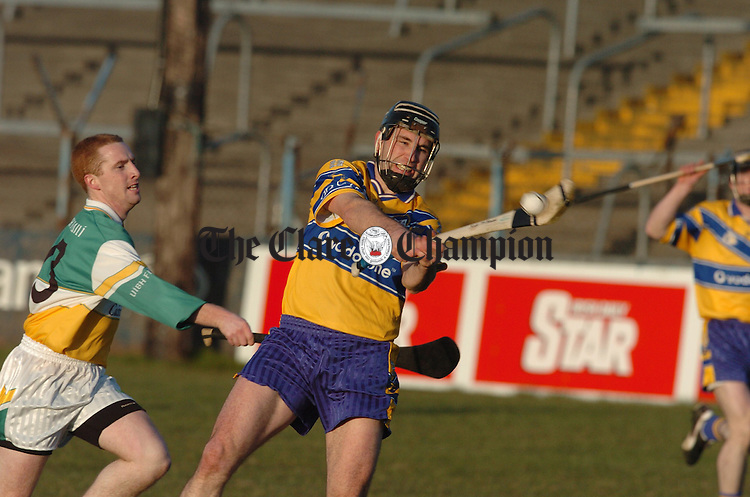 Offaly's Simon Whelehan  moves in on Clare's Sean Mc Mahon during their challenge game in Cusack Park. Photograph by John Kelly.