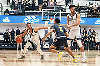 WASHINGTON, DC - FEBRUARY 22: Scott Spencer #2 of La Salle moves up on Armel Potter #2 of George Washington during a game between La Salle and George Washington at Charles E Smith Center on February 22, 2020 in Washington, DC.