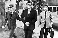 1973 File - Wealthy contractor Peter Demeter (centre) is led into Brampton Jail today by Det.-Sgt. Chris O'Toole (left) and Police Superintendent William Teggert after being charged with the non-capital murder of his wife; Chritine; 33. She was found lying in a pool of blood on the floor of the garage of their $100;000 Mississauga home on July 18. She was a former model.<br /> <br /> Photo : Boris Spremo - Toronto Star archives - AQP