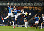 Nicky Clark and Kris Boyd mix it up in the Inverness box