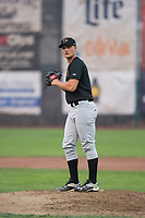 Great Falls Voyagers relief pitcher Chris Comito (19) gets ready to deliver a pitch during a Pioneer League against the Ogden Raptors at Lindquist Field on August 23, 2018 in Ogden, Utah. The Ogden Raptors defeated the Great Falls Voyagers by a score of 8-7. (Zachary Lucy/Four Seam Images)