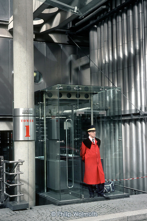 Uniformed doorman at the Lloyds Building in the City of London