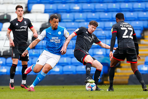 1st May 2021; Weston Homes Stadium, Peterborough, Cambridgeshire, England; English Football League One Football, Peterborough United versus Lincoln City; Conor McGrandles of Lincoln City holds the ball up under pressure from Jonson Clarke-Harris of Peterborough United