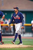 Danville Braves pitching coach Kanekoa Texeira (50) walks to the mound for a visit during a game against the Johnson City Cardinals on July 28, 2018 at TVA Credit Union Ballpark in Johnson City, Tennessee.  Danville defeated Johnson City 7-4.  (Mike Janes/Four Seam Images)