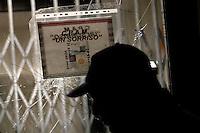 Il vetro rotto all'entrata del centro<br /> broken glasses<br /> Roma 12-11-2014 Tor Sapienza. Nella serata di ieri, dopo una manifestazione avvenuta nel pomeriggio, un centinaio di abitanti del quartiere, hanno lanciato sassi e bombe carta verso il centro di accoglienza per rifugiati di via Morandi, aperto nel loro quartiere. All'arrivo di un ingente dispiegamento di forze dell'ordine, gli abitanti hanno bruciato dei cassonetti per sbarrare la strada ed hanno tirato verso gli agenti oggetti vari dalle finestre, tra i quali e' stato rinvenuto un coltello da cucina, generando una vera e propria guerriglia urbana. 4 poliziotti sono rimasti feriti e sono state danneggiate macchine della polizia. La polizia si e' infine schierata a protezione del centro di accoglienza. <br /> In Rome's Tor Sapienza quarter, where 36 immigrants live, one hundred people tried to enter the center, throwing home made bombs, to chase away the immigrants. When the police arrived, the inhabitants burned garbage bins and throw objects from windows, among them a cooking knife. In the end the police trooped in front of the immigrant center to protect it.<br /> Photo Samantha Zucchi Insidefoto