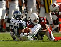 Nov. 6, 2005; Tempe, AZ, USA; Running back (37) Shaun Alexander of the Seattle Seahawks is tackled by cornerback (25) Eric Green of the Arizona Cardinals at Sun Devil Stadium. Mandatory Credit: Mark J. Rebilas