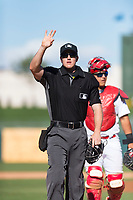 Home plate umpire Brennan Miller and catcher Jeremy Martinez (4) walk back towards home plate after a mound visit during an Arizona Fall League game between the Surprise Saguaros and the Peoria Javelinas at Surprise Stadium on October 17, 2018 in Surprise, Arizona. (Zachary Lucy/Four Seam Images)