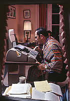 Businessman at work on home computer, 1970. The computer system, known as 'time-sharing,' consisted of a teletype terminal connected to a big central unit via telephone. Photo by John G. Zimmerman.