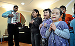 A children's choir sings during a worship service of the United Methodist Roma congregation in Jabuka, Serbia..
