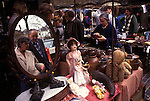 Street market London. Golborne Road north end of Portobello Road.  Saturday traditional antique and brick-a-bat market stall. Woman market stall holder. 1990s UK 1999. Golborne Road was where much of the film Notting Hill was shot on location.