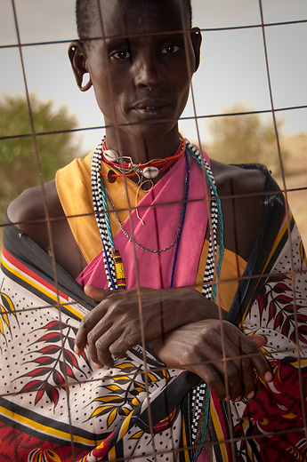 Maasai wear bright color robes, or lubegas, preferably with some touch of red or orange. Women will also wear more embroidery in the form of beadwork than men and younger women decorate themselves more than their seniors.  Women's heads are always clean shaven regardless of age - only Maasai warriors are allowed to wear their hair long.