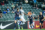 SC Kitchee Defender Helio de Souza (l) fights for the ball with Auckland City Forward Joao Moreira (r) during the Nike Lunar New Year Cup 2017 match between SC Kitchee (HKG) and Auckland City FC (NZL) on January 31, 2017 in Hong Kong, Hong Kong. Photo by Marcio Rodrigo Machado / Power Sport Images