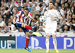 Real Madrid's Sergio Ramos (r) and Atletico de Madrid's Koke Resurrecccion during Champions League 2014/2015 Quarter-finals 2nd leg match.April 22,2015. (ALTERPHOTOS/Acero)