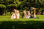 Two students relax on the grass at University of Portland.