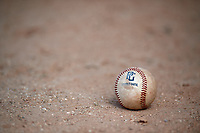 A baseball sits on the ground during the WWBA World Championship at the Roger Dean Complex on October 20, 2018 in Jupiter, Florida.  (Mike Janes/Four Seam Images)