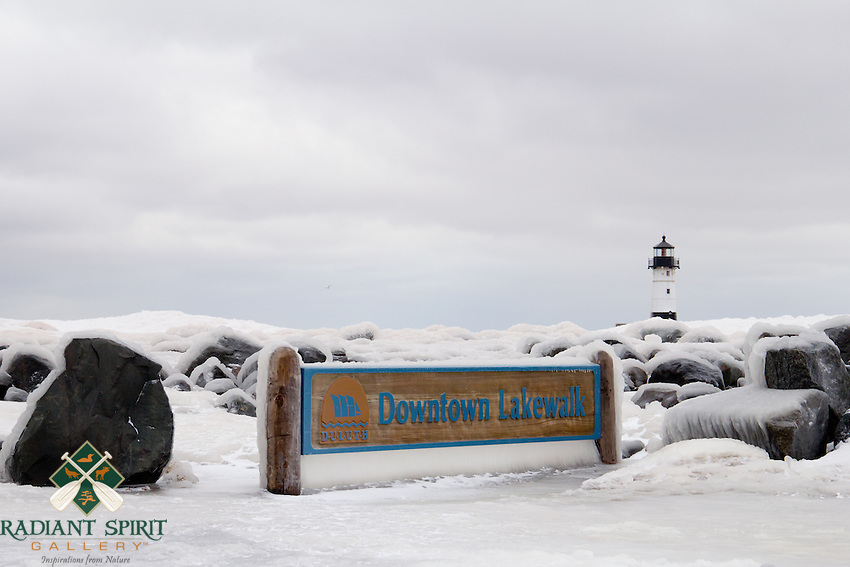 """""""Icewalk""""<br /> <br /> Following a February winter storm, Duluth's Lakewalk and Canal Park were encased in ice."""