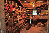The inside of one side of an early 20th century or late 19th century blacksmiths shop used at a saw mill to make and repair tools in Occidental California.  It shows the cubbyholes where equipment was stored.