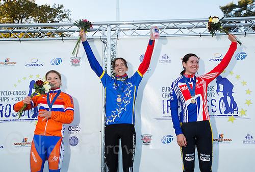 03 NOV 2012 - IPSWICH, GBR - Helen Wyman (GBR) (centre) of Great Britain celebrates winning the Elite Women's European Cyclo-Cross Championships in Chantry Park, Ipswich, Suffolk, Great Britain flanked by silver medalist Sanne van Paassen (NED) (left) of the Netherlands and bronze medalist Nikki Harris (GBR) (right) of Great Britain .(PHOTO (C) 2012 NIGEL FARROW)