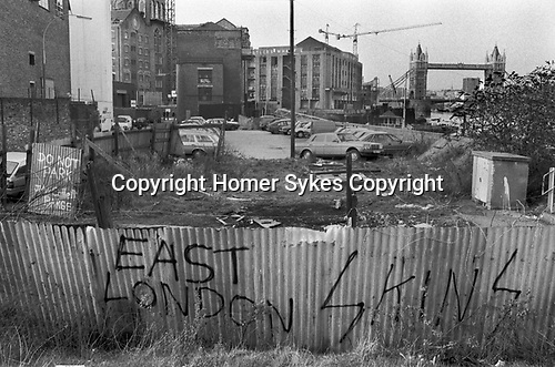Shad Thames Bermondsey South East London 1980s UK. Now called  Bermondsey Wall West just east  of St Saviours Dock Footbridge, looking north to Butlers Wharf. Car park is now a sort of garden.  Docklands redevelopment 1987 England