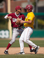 LOS ANGELES, CA - April 10, 2011: Lonnie Kauppila of Stanford baseball throws to first after tagging out a runner to complete a double play during Stanford's game against USC at Dedeaux Field in Los Angeles. Stanford lost 6-2.