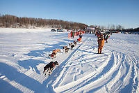 Merideth Mapes leaves the start line of the Junior Iditarod start at Knik Lake, Knik, Alaska
